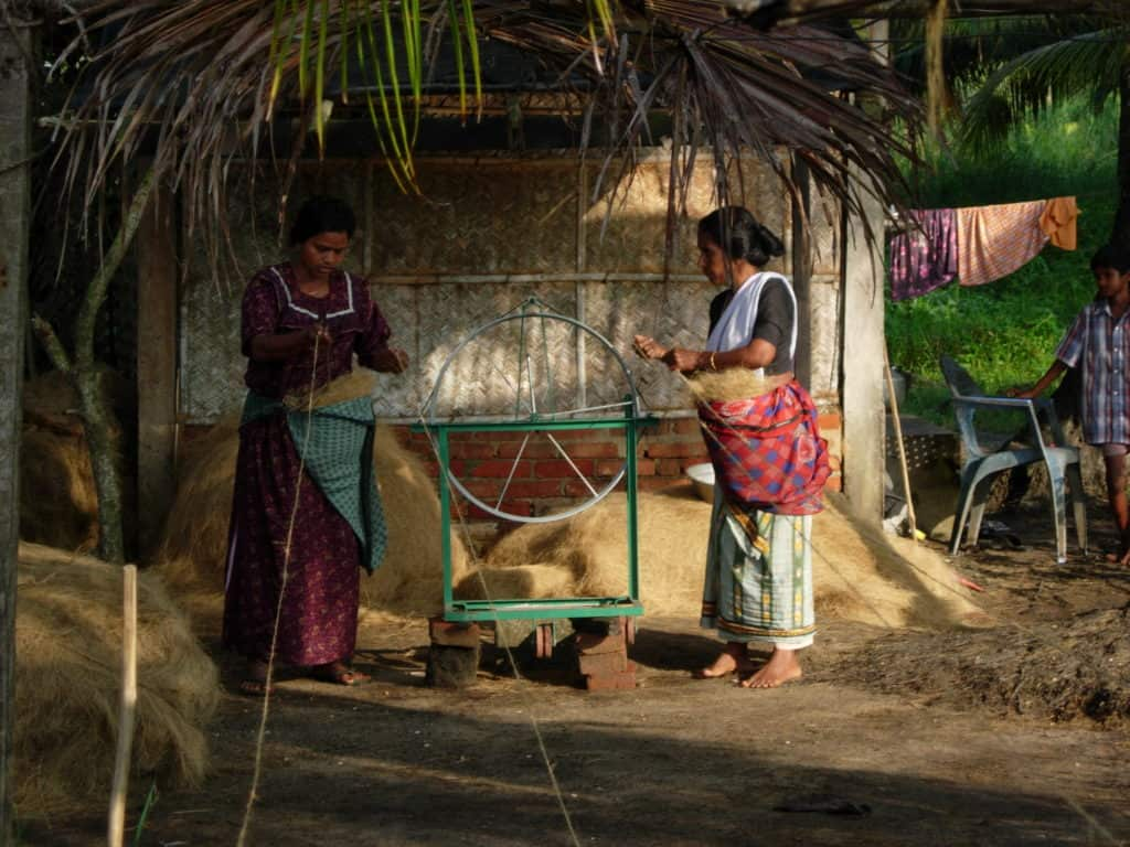 Women working a small scale coir unit in India